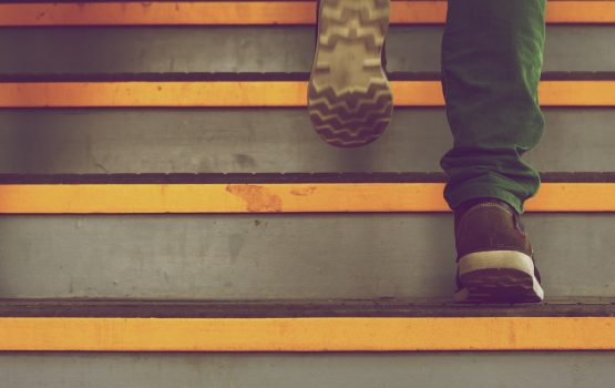 Person climbing stairs - it's a journey
